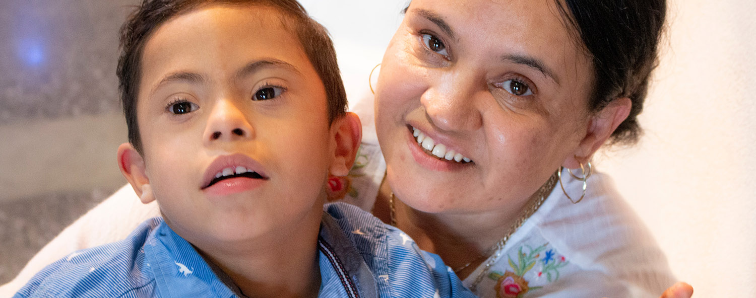 <p>Mom holding son with Down syndrome</p>