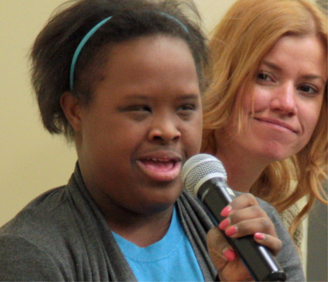 woman with down syndrome speaking to an audience